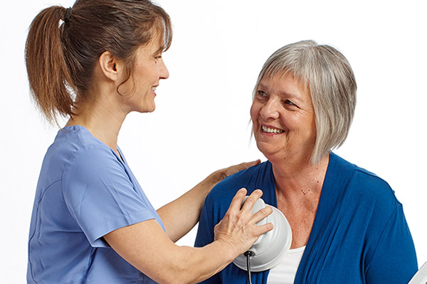 Nurse with Frequencer on Older Woman